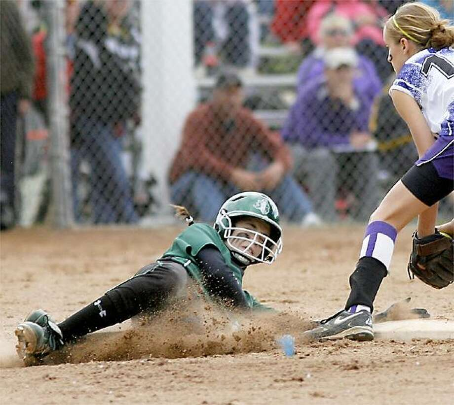 """Dispatch Staff Photo by JOHN HAEGER <a href=""""http://twitter.com/oneidaphoto"""">twitter.com/oneidaphoto</a>Hamilton's Caitlyn Purdy (2) slides safely into second on the steal during the Section III Class D Championship in Liverpool on Saturday, June 2, 2012."""
