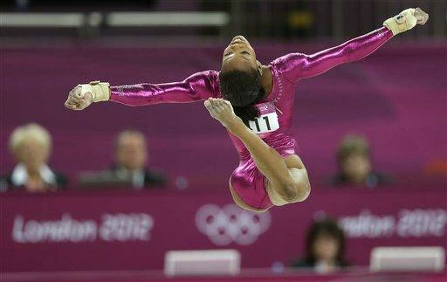 U.S. gymnast Gabrielle Douglas performs on the floor during the artistic gymnastics women's individual all-around competition at the 2012 Summer Olympics, Thursday, Aug. 2, 2012, in London. (AP Photo/Gregory Bull) Photo: AP / AP