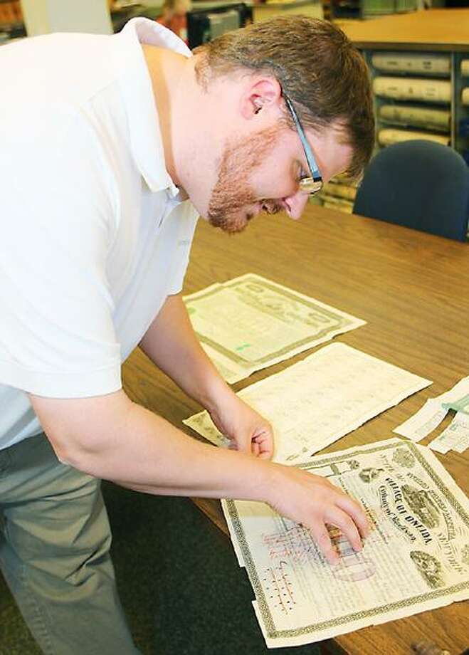 "Dispatch Staff Photo by JOHN HAEGER <a href=""http://twitter.com/oneidaphoto"">twitter.com/oneidaphoto</a> Madison County Historian Matt Urtz talks about a 1866 railroad bond for the Village of Oneida that will be among the bonds and maps and other related railroad items that will be displayed at the county office building in Wampsville this coming Wednesday."