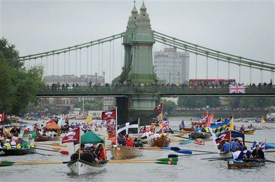 Boats begin to gather near Hammersmith Bridge on the River Thames, London, during the Diamond Jubilee river pageant Sunday. More than 1,000 boats were to sail down the River Thames on Sunday in a flotilla tribute to Queen Elizabeth II's 60 years on the throne that organizers are calling the biggest gathering on the river for 350 years. Associated Press Photo: AP / PA