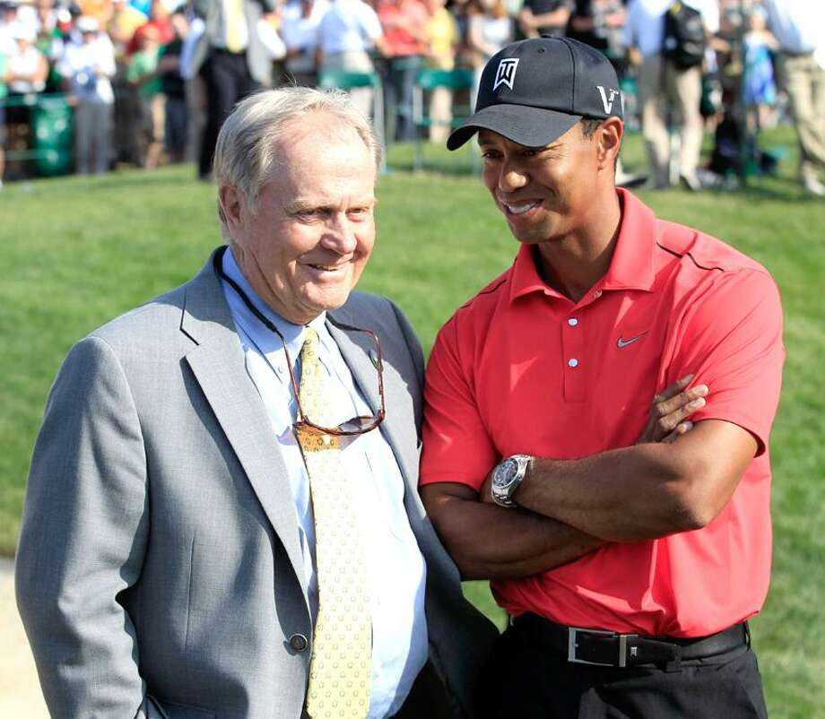 Jack Nicklaus, left, talks with Tiger Woods after Woods won the Memorial golf tournament at the Muirfield Village Golf Club in Dublin, Ohio, Sunday, June 3, 2012. (AP Photo/Tony Dejak) Photo: AP / AP2012