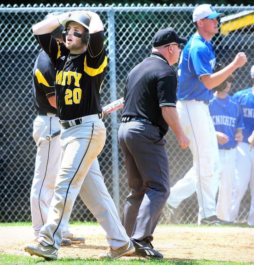 Paul Gusmano (left) of Amity reacts after being called out at the plate against Southington in the fourth inning on 6/3/2012.  At right is Southington pitcher Justin Robarge.Photo by Arnold Gold/New Haven Register