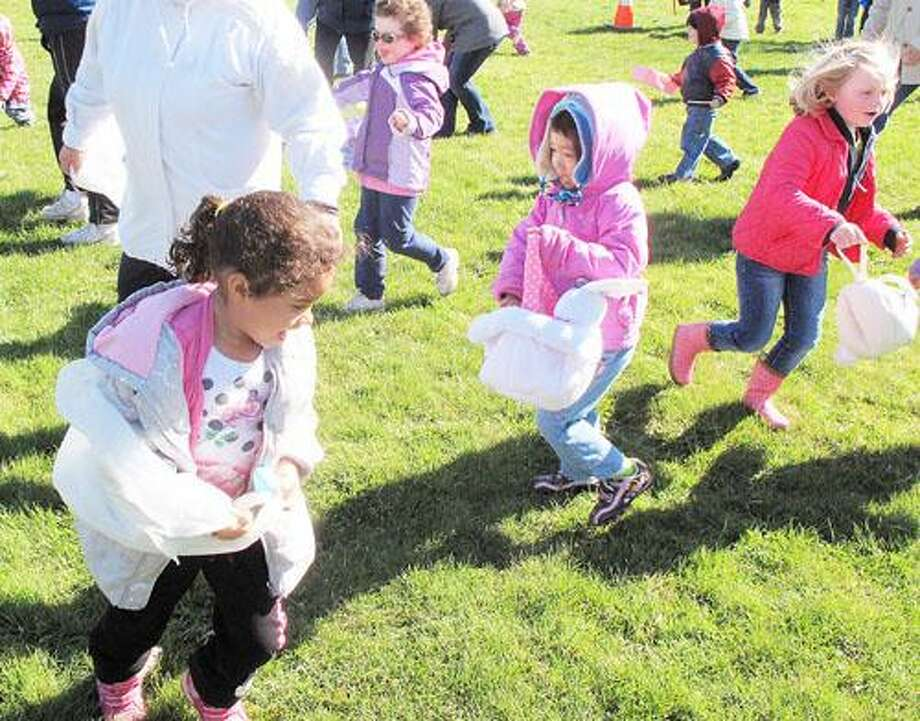 Dispatch Staff Photo by JOHN HAEGER (Twitter.com/OneidaPhoto) Children race to find some of the 1,300 eggs laid out at the CAC in Sherrill during the an Easter Egg hunt on Friday, April 6, 2012.