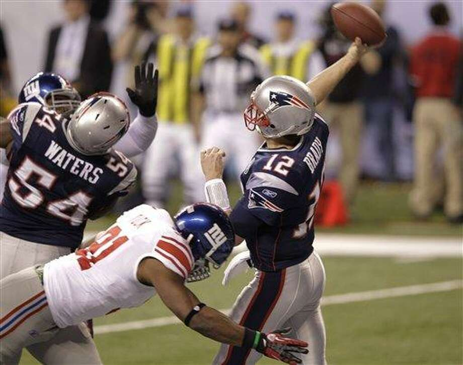 New York Giants defensive end Justin Tuck sacks New England Patriots quarterback Tom Brady for a safety during the first half of NFL Super Bowl XLVI football game, Sunday, Feb. 5, 2012, in Indianapolis. (AP Photo/Michael Conroy) Photo: AP / AP