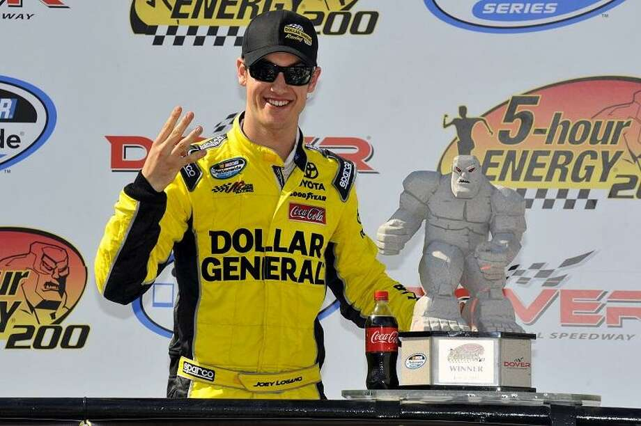 Joey Logano, Dollar General Toyota Camry celebrates in Victory Lane after his win during the 5 Hour Energy 200 Race auto race at Dover International Speedway on Saturday June 2, 2012 in Dover Del. (AP Photo/Autostock, Nigel Kinrade) Photo: ASSOCIATED PRESS / AP2012