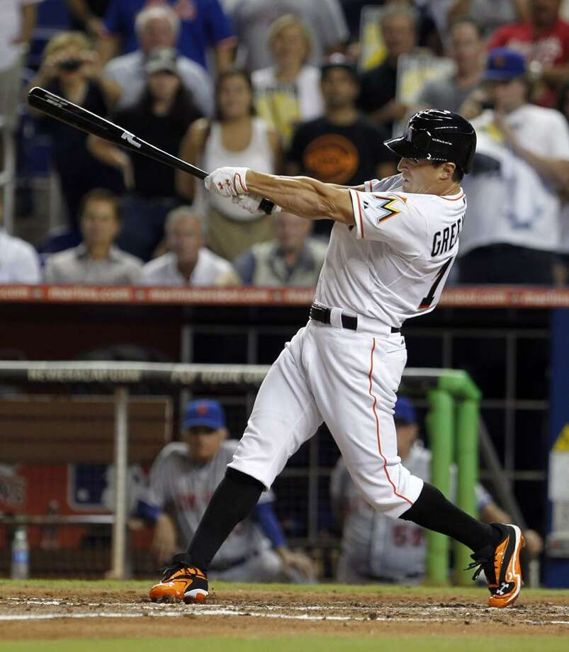 Miami Marlins' Adam Greensberg swings at the third strike against the New York Mets during the sixth inning of a baseball game in Miami, Tuesday, Oct. 2, 2012. (AP Photo/Alan Diaz) Photo: AP / AP2012