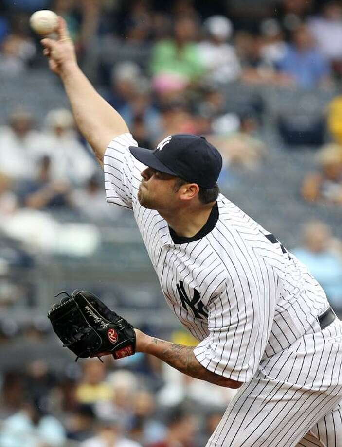 Joba Chamberlain pitched for the Yankees for the first time in more than a year in Wednesday's game against the Orioles. Chamberlain threw 28 pitches in 1 2/3 innings, allowing four hits -- including a home run -- and one walk in the Yankees' 12-3 win. (AP photo) Photo: AP / AP