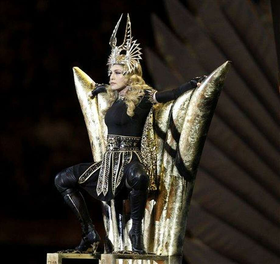 Madonna performs during halftime of the NFL Super Bowl XLVI football game between the New York Giants and the New England Patriots, Sunday, Feb. 5, 2012, in Indianapolis. (AP Photo/Matt Slocum) Photo: AP / AP