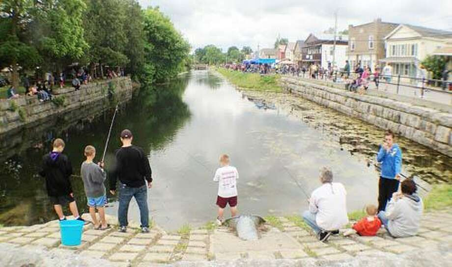 Photo by JOHN HAEGER (Twitter.com/OneidaPhoto) Children line the banks of the Erie Canal in the Village of Canastota as they take part in the 40th annual Over the Hill Gang Fishing Derby on Sunday, June 3, 2012.
