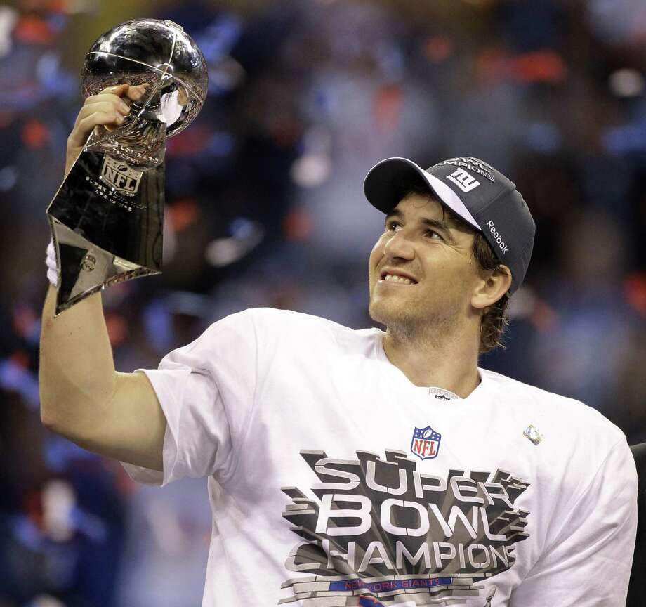 New York Giants quarterback Eli Manning celebrates with the Vince Lombardi Trophy after the Giants' 21-17 win over the New England Patriots in the NFL Super Bowl XLVI football game, Sunday, Feb. 5, 2012, in Indianapolis. (AP Photo/Chris O'Meara) Photo: ASSOCIATED PRESS / AP2012