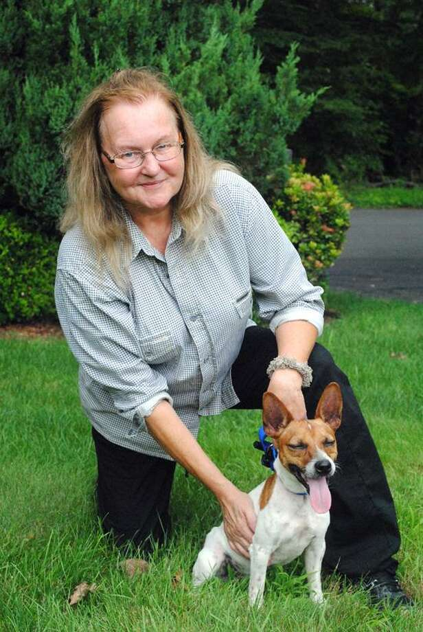Ellen, the proud new owner who adopted the Jack Russell terrier named Jax. Photo by Jen Fengler/ for the Register