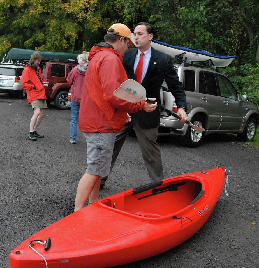 CROMWELL-DEP Commissioner Dan Esty leads an afternoon of exploring the resourses of the Connecticut and Mattabesset Rivers. State Sen. Paul Doyle gets some help from Mark Chanski, left, of the DEEP Boating Division as he unloads his kayak.    Melanie Stengel/New Haven Register Photo: New Haven Register / ©PMelanoie Stengel/ New Haven Register