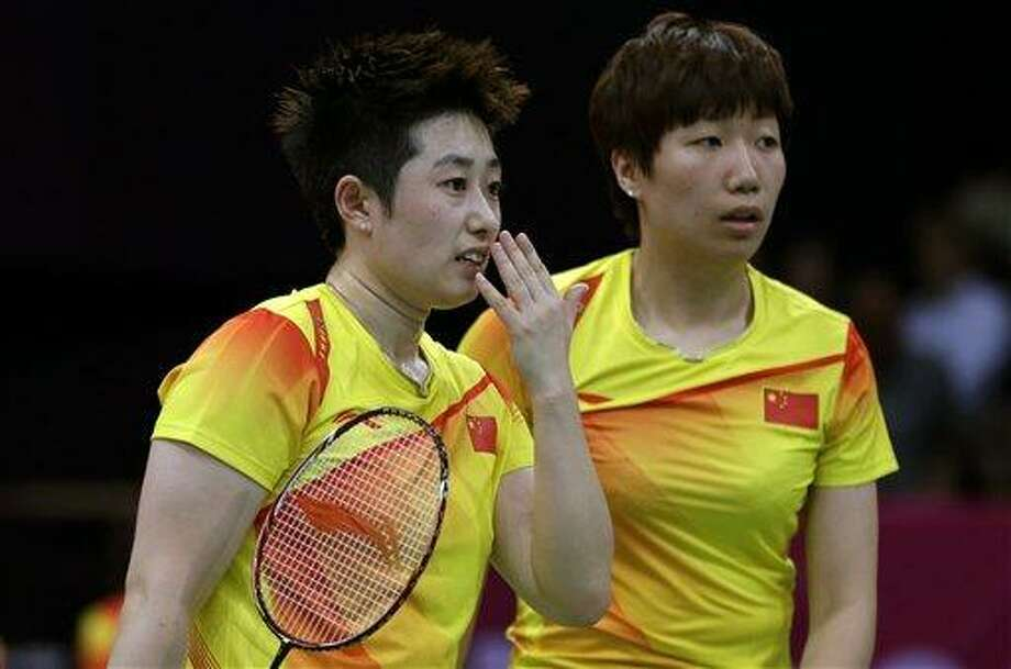 China's Yu Yang, left, and Wang Xiaoli talk while playing against Jung Kyun-eun and Kim Ha-na, of South Korea, in a women's doubles badminton match at the 2012 Summer Olympics, Tuesday, July 31, 2012, in London.  World doubles champions Wang and Yu, and their South Korean opponents were booed loudly at the Olympics on Tuesday for appearing to try and lose their group match to earn an easier draw. (AP Photo/Andres Leighton) Photo: AP / AP