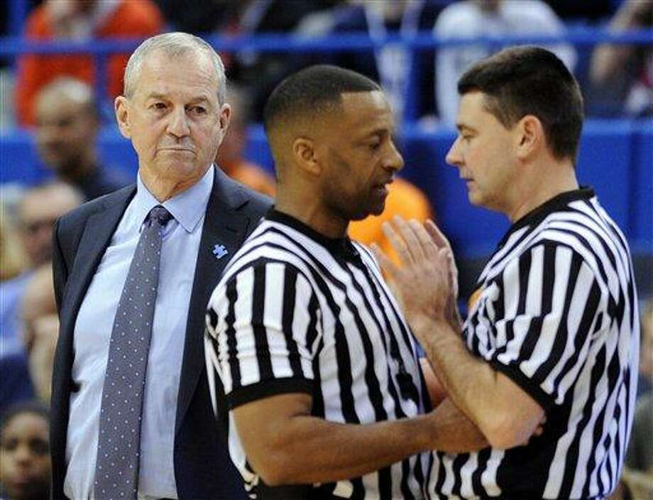 Connecticut coach Jim Calhoun, left, looks on as officials discuss a call during the first half of Connecticut's 64-57 victory over West Virginia in an NCAA college basketball game in Hartford, Conn., on Monday, Jan. 9, 2012. (AP Photo/Fred Beckham) Photo: ASSOCIATED PRESS / AP2012