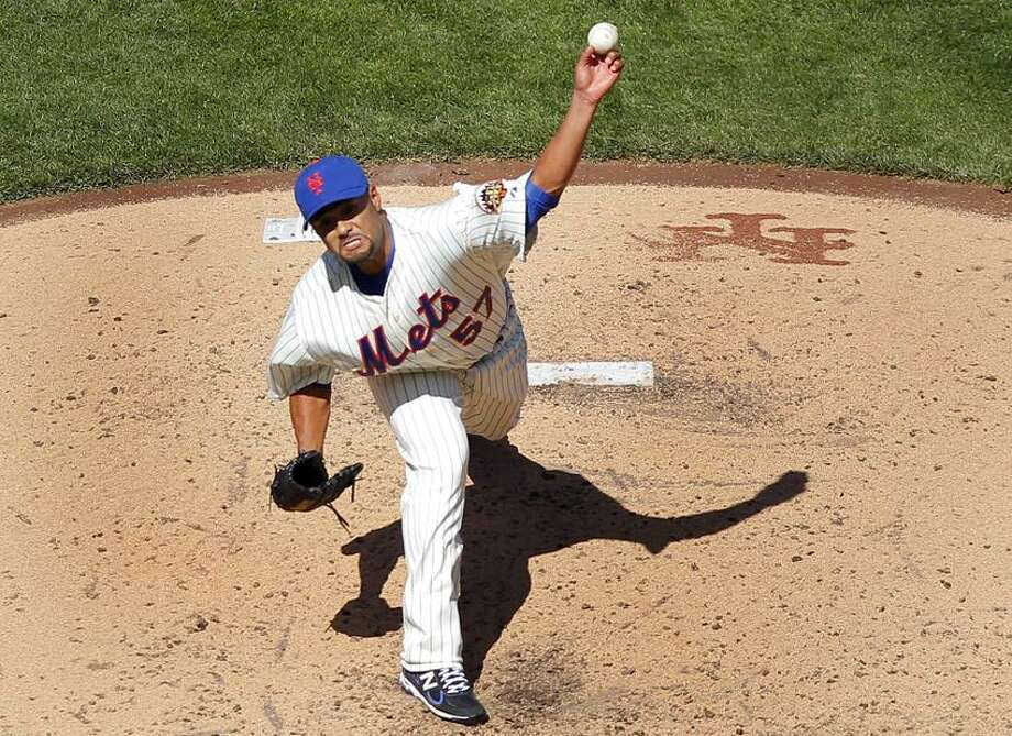 New York Mets starting pitcher Johan Santana throws against the Atlanta Braves during the fifth inning of their MLB National League opening day baseball game at CitiField in New York April 5, 2012.   REUTERS/Adam Hunger  (UNITED STATES - Tags: SPORT BASEBALL) Photo: REUTERS / X01873