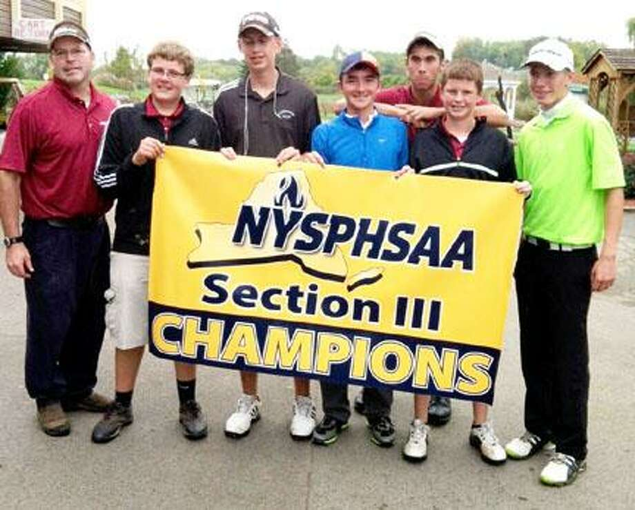 Submitted Photo Chittenango's boys golf team, from left, coach Dan Kelly, Ryan Delaney, Kyle McGinnis, Sean Murray, Erik Russell, Kyler Christopher and Mike McIntosh, hoists the NYSPHSAA Section III Championship banner Tuesday. The team shot a 434 to win the Section III Class B title Tuesday at Foxfire.