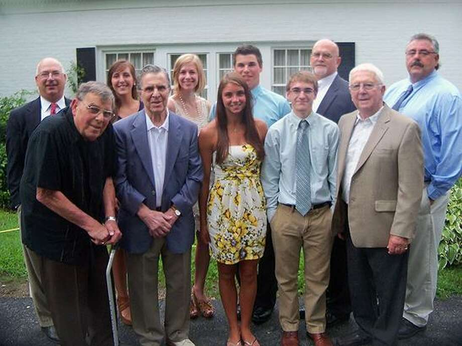Torrington Varsity Alumni Club officers and scholarship award winners are, front row, left to right, Dominic Toce; Andy Pace; Krista Traub; Jesse Rosengrant; Lou Zanderigo. Back row, left to right: Paul O'Heron; Christine Keywan; Maggie Finn; Nick Tedesco; Paul Denza; Fred Bonvicini.