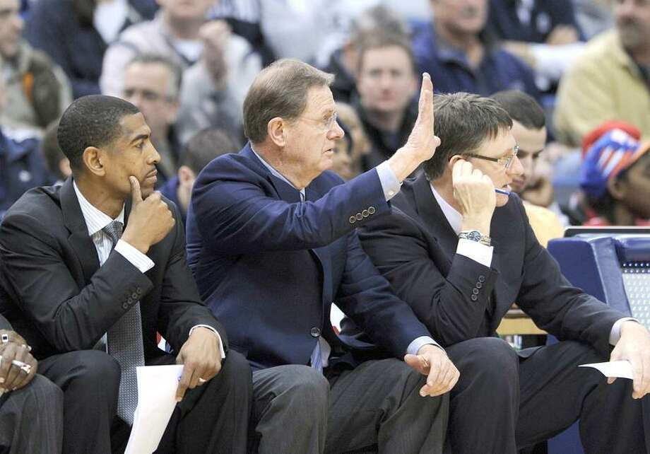 Connecticut associate head coach George Blaney, center, signals to his team during the first half of an NCAA college basketball game against Seton Hall in Hartford, Conn., on Saturday, Feb. 4, 2012. Blaney took over the coaching duties from coach Jim Calhoun who went on medical leave. (AP Photo/Fred Beckham) Photo: AP / AP2012