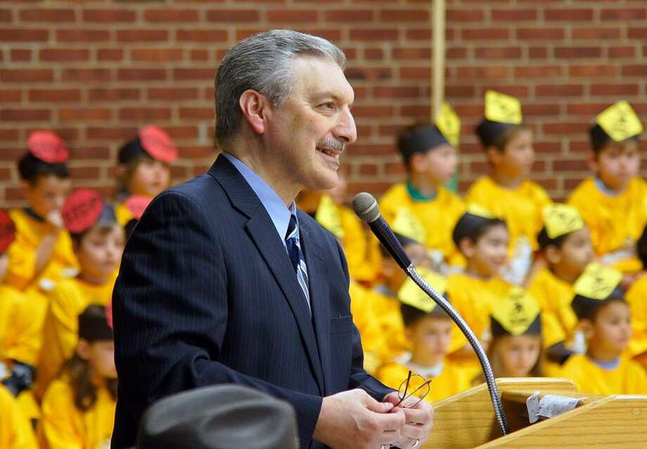SONY DSCOrange--Principal Ralph Nuzzo of Mary L. Tracy School in Orange conducts the D.A.R.E. Assembly at the school which graduated scores of Kindergartners. Photo- Peter Casolino/New Haven Register 04/30/12