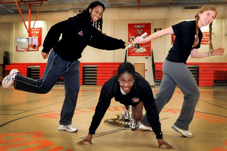 SPORTS_Left to right-Wilbur Cross indoor track Capts. Tiffany Goodridge, Deanna Jones, and Annakate (cq) Schatz.   Melanie Stengel/Register