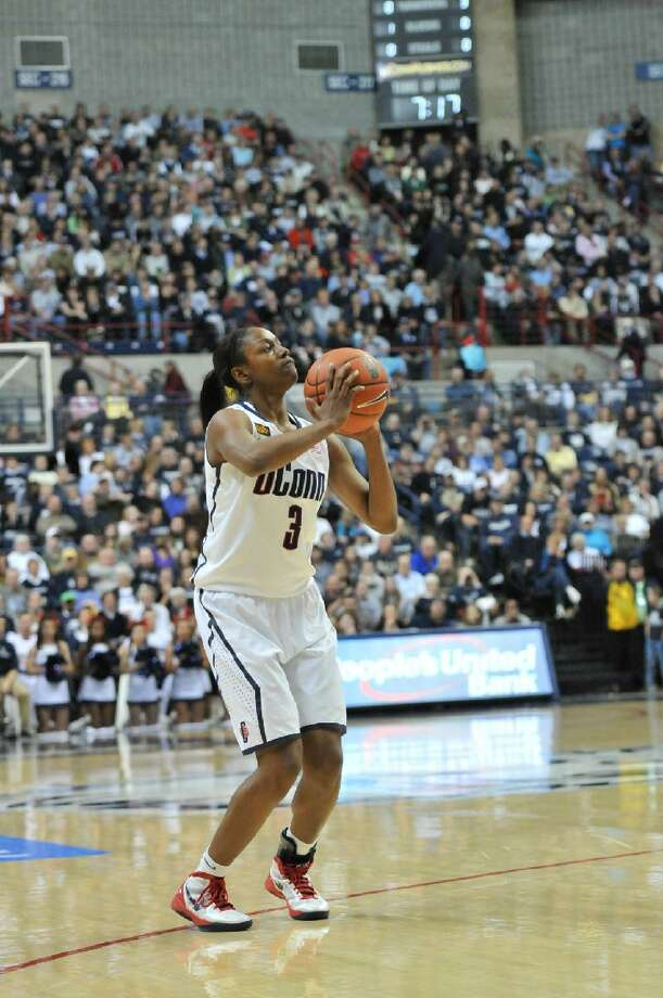 ASSOCIATED PRESS Connecticut's Tiffany Hayes sets up for a shot during the first half of Saturday night's game against Rutgers at Gampel Pavilion in Storrs. The Huskies won 66-34.
