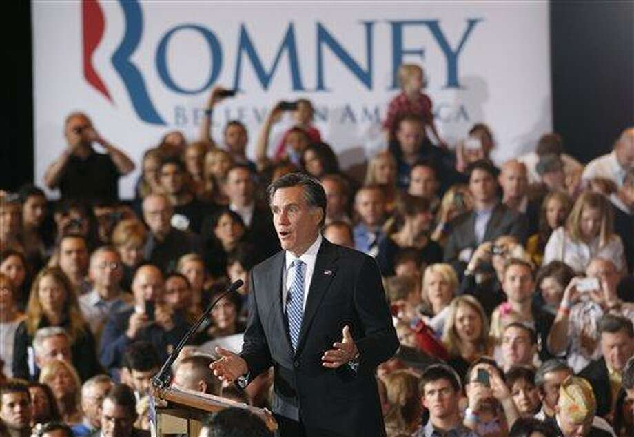 Republican presidential candidate former Massachusetts Gov. Mitt Romney speaks at his Nevada caucus night victory celebration in Las Vegas, Saturday, Feb. 4, 2012. (AP Photo/Gerald Herbert) Photo: AP / AP