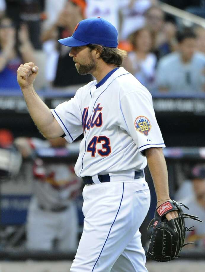 ASSOCIATED PRESS New York Mets starting pitcher R.A. Dickey pumps his fist after the Mets shut out the St. Louis Cardinals 5-0 Saturday at Citi Field in New York.