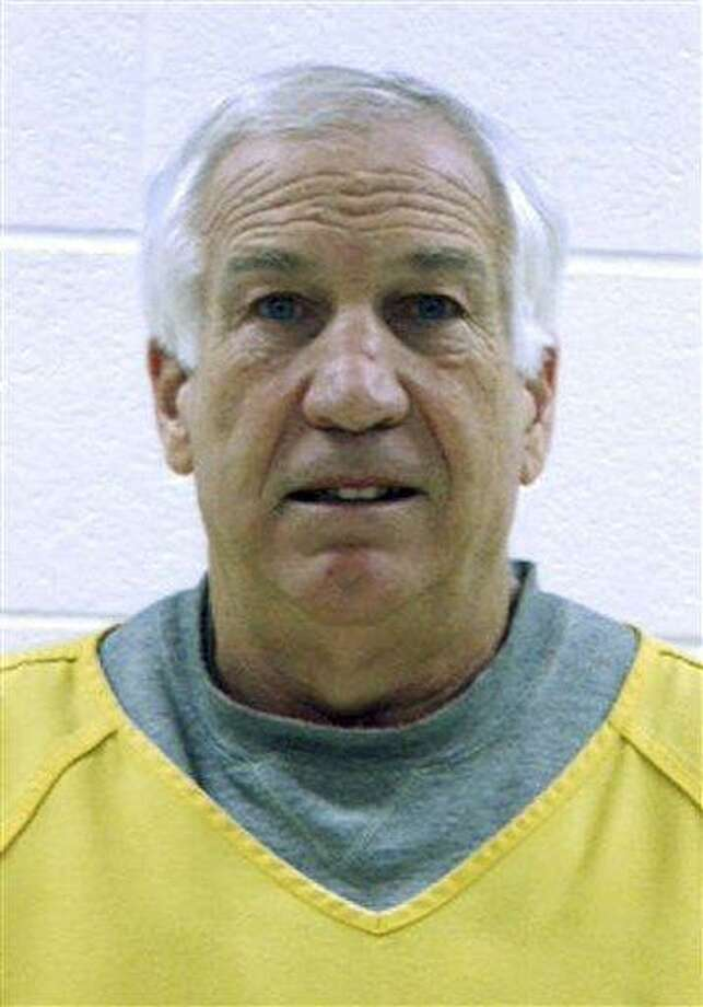 "This 2011 booking photo, released by the Centre County Correctional Facility in Bellefonte, Penn., shows former Penn State football defensive coordinator Gerald ""Jerry"" Sandusky, who was arrested and arraigned on new sex abuse charges brought by two new accusers.  Associated Press Photo: AP / Centre County Correctional Facility"