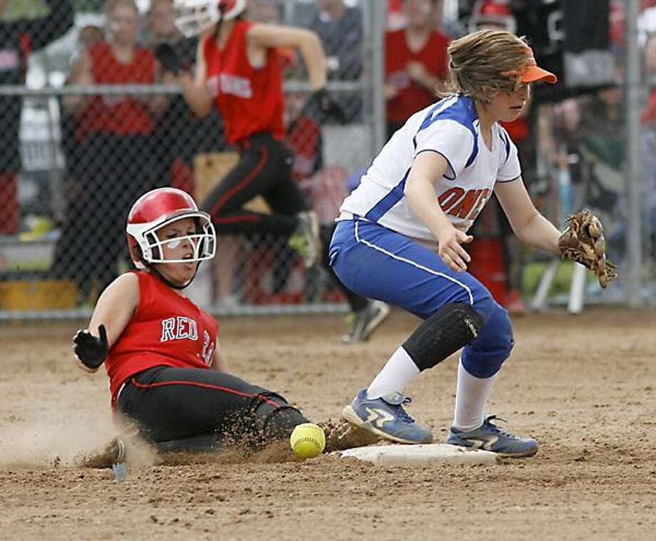 """Dispatch Staff Photo by JOHN HAEGER <a href=""""http://twitter.com/oneidaphoto"""">twitter.com/oneidaphoto</a>J-D's Mary Young (22) slides into second as Oneida's Lexi Skibitski (3) bobbles the ball in the top of the fifth Inning of Sec III Class A Championship in Liverpool on Saturday, June 2, 2012."""