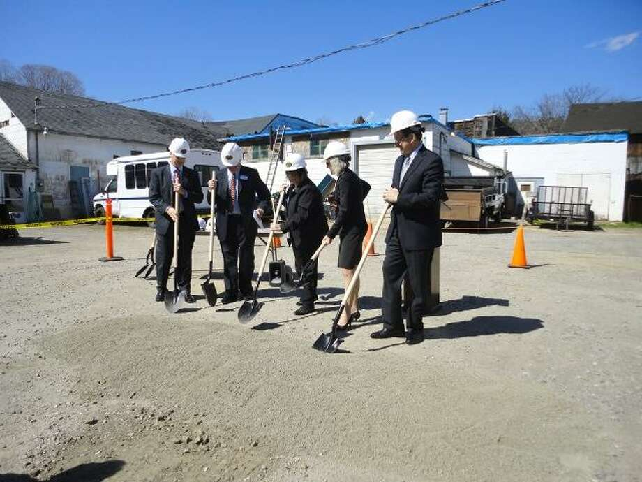 "JASON SIEDZIK/ Register Citizen Northwest Community Bank president Stephen Reilly, Winchester Housing Authority executive director Fred Newman, Winchester mayor Maryann Welcome, Connecticut Department of Economic and Community Development commissioner Catherine Smith and Connecticut governor Dannel Malloy picked up shovels and officially broke ground on Carriage Maker Place. To purchase a glossy photo of this picture, visit <a href=""http://registercitizen.com"">registercitizen.com</a>."