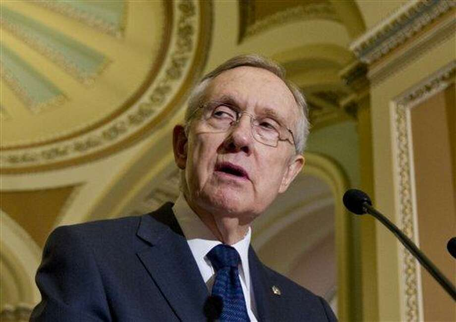 Senate Majority Leader Harry Reid, D-Nev., talks to reporters following the Democrats' weekly strategy session at the Capitol in Washington Tuesday. Associated Press Photo: AP / The Associated Press