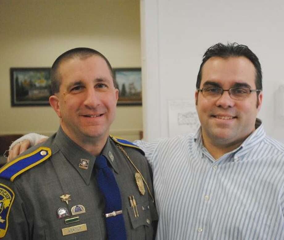 MIKE AGOGLIATI/Register Citizen Harwinton Resident Trooper Bill Arbour, left, was welcomed to the job by First Selectman Michael Criss last week.