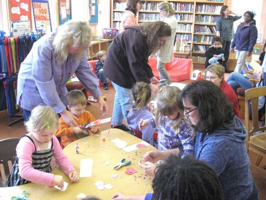 """Photo by Karin Taylor Kids make bookmarks at the Beardsley and Memorial Library's first Take Your Child to the Library Day. To purchase a glossy photo of this picture, visit <a href=""""http://registercitizen.com"""">registercitizen.com</a>."""