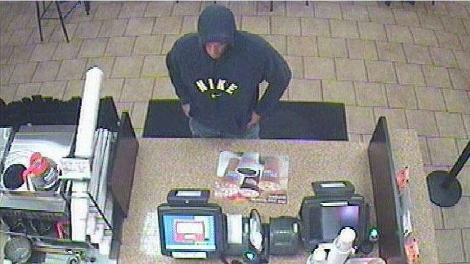 Police are looking for the suspect in the robbery of a Dunkin' Donuts Friday in Milford.