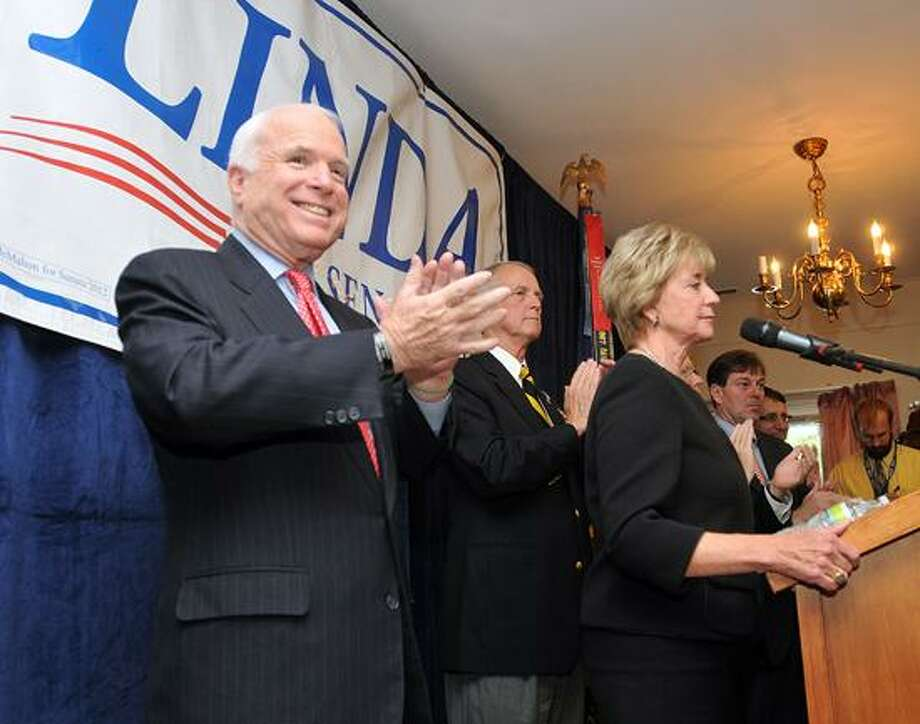 Sen. John McCain claps as Republican Senatorial candidate Linda McMahon speaks as he endorsed her at a campaign rally at the Disabled American Veterans Hall in Danbury. Photo Peter Casolino/New Haven Register