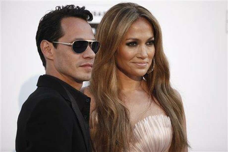 """In a May 20, 2010 file photo, singers Marc Anthony and Jennifer Lopez arrive for the amfAR Cinema Against AIDS benefit during the 63rd Cannes international film festival, in Cap d'Antibes, southern France. The exes have announced that they'll perform together on May 26 in Las Vegas as part of """"Q'Viva! The Chosen Live,"""" which will feature the top talent from their televised talent show. (AP Photo/Matt Sayles, File) Photo: AP / AP2010"""