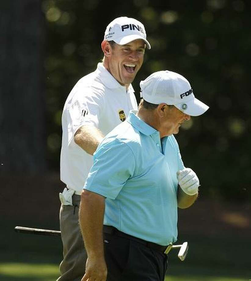 Lee Westwood, left, of England, jokes with Ian Woosnam, of Wales, on the 11th fairway during their practice round for the Masters golf tournament Monday, April 2, 2012, in Augusta, Ga. (AP Photo/Chris O'Meara) Photo: ASSOCIATED PRESS / AP2012