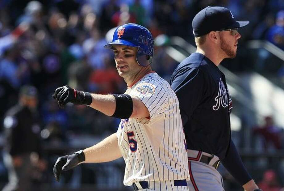 New York Mets' David Wright (5)  reacts while walking past Atlanta Braves first baseman Freddie Freeman after hitting an hits an RBI single during the sixth inning of the an opening day baseball game at Citi Field, Thursday, April 5, 2012, in New York.  (AP Photo/Frank Franklin II) Photo: ASSOCIATED PRESS / AP2012