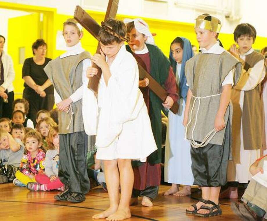 "Dispatch Staff Photo by JOHN HAEGER <a href=""http://twitter.com/oneidaphoto"">twitter.com/oneidaphoto</a> St. Patrick's sixth-grader Scott Potter portrays Jesus as he and classmates act out the Stations of the Cross on Wednesday, April 4, 2012 at the school."