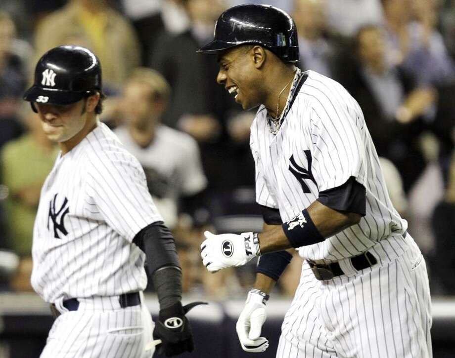 New York Yankees' Curtis Granderson, right, celebrates with Nick Swisher after they both scored on Granderson's second-inning, two-run home run during their baseball game against the Boston Red Sox at Yankee Stadium in New York, Monday, Oct. 1, 2012. (AP Photo/Kathy Willens) Photo: AP / AP