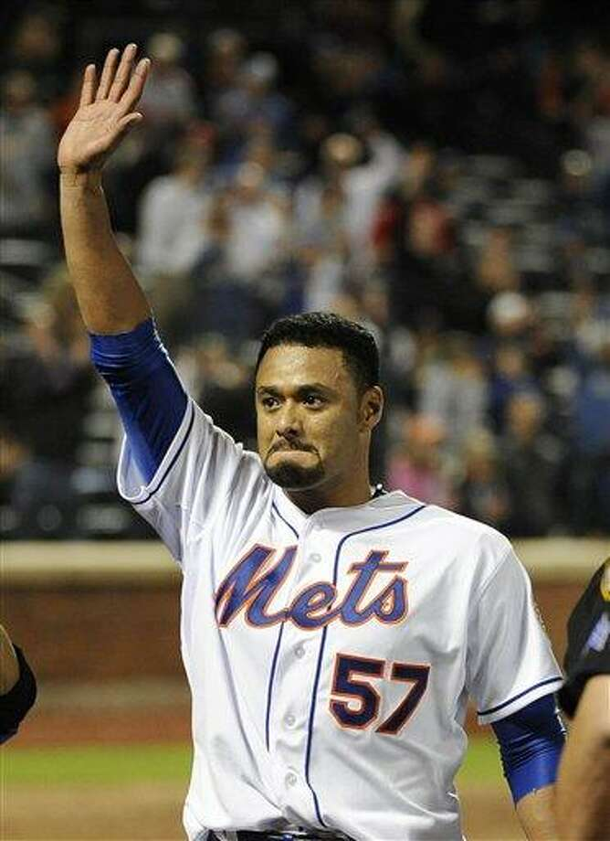 New York Mets starting pitcher Johan Santana (57) celebrates his no-hitter against the St. Louis Cardinals at the end of a baseball game on Friday, June 1, 2012, at Citi Field in New York. The Mets won 8-0. (AP Photo/Kathy Kmonicek) Photo: ASSOCIATED PRESS / AP2012