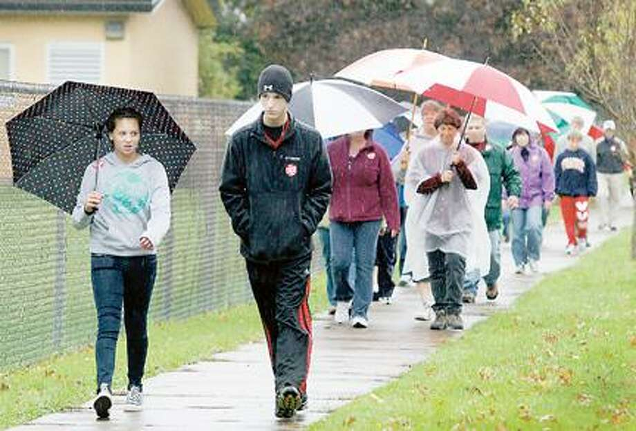 """Dispatch Staff Photo by JOHN HAEGER <a href=""""http://twitter.com/oneidaphoto"""">twitter.com/oneidaphoto</a> Walkers make their way along Seneca Street in the city of Oneida as they take part in the last year's CROP Walk."""
