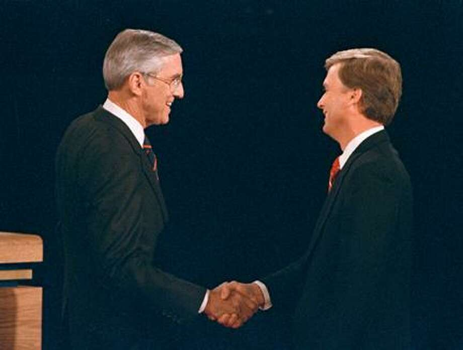 Sen. Lloyd Bentsen, D-Texas, left, shakes hands with Sen. Dan Quayle, R-Ind., before the start of their 1988 vice presidential debate in Omaha, Neb. Presidential candidates and their running mates often find that campaign debates turn on unplanned zingers, gaffes or gestures that speak volumes. Photo: AP / AP