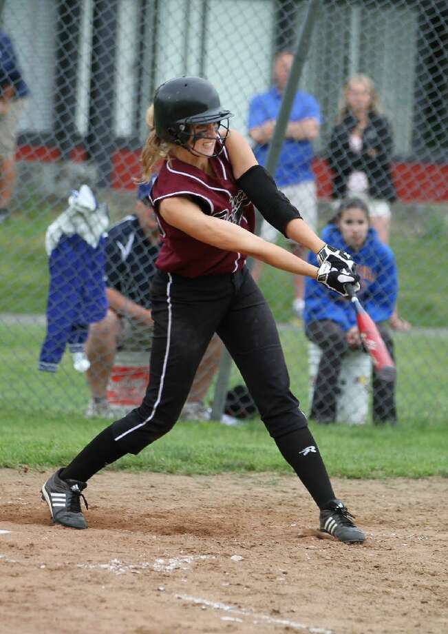 MARIANNE KILLACKEY/Register Citizen Correspondent Torrington's Sydney Matzko follows through on her RBI triple during the bottom of the sixth inning of Friday afternoon's Class L softball quarterfinal game against Brookfield at Torrington High School. The Lady Raiders lost 5-1. Torrington ended its season with a program-best 21-4 record.