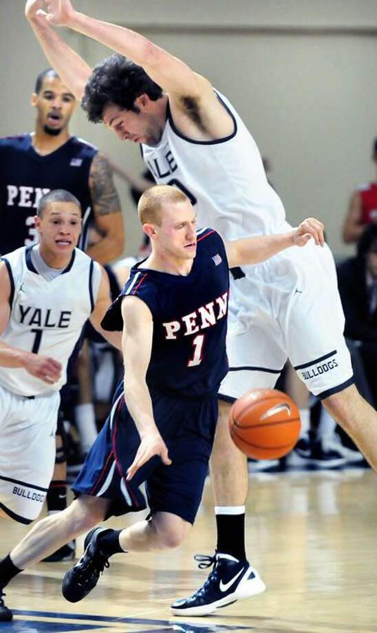 Zack Rosen (center) of Penn dribbles around Jeremiah Kreisberg (top) of Yale in the first half on 2/3/2012.Photo by Arnold Gold/New Haven Register     AG0438A