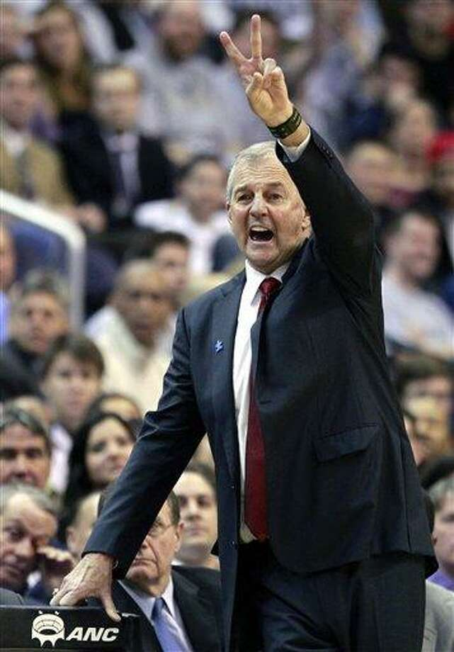 Connecticut head coach Jim Calhoun directs his team during the second half of an NCAA college basketball game against Georgetown, Wednesday, Feb. 1, 2012, in Washington. Georgetown won 58-44. (AP Photo/Haraz Ghanbari) Photo: ASSOCIATED PRESS / AP2012