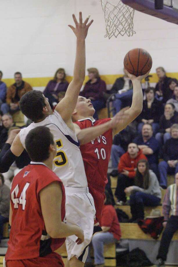 """Dispatch Staff Photo by JOHN HAEGER <a href=""""http://twitter.com/oneidaphoto"""">twitter.com/oneidaphoto</a> VVS' Jesse Whitmeyer (10) puts up a shot for two as Holland Patent's Nate Palmer (15) reaches up to defend in the first half of their game on   Friday Feb. 3, 2012 in Holland Patent."""