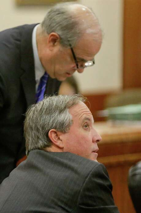 The securities fraud case against Texas Attorney General Ken Paxton, front, shown with Phil Hilder, one of the attorneys representing him, will be heard in a Houston courtroom. Photo: Melissa Phillip, Staff / Houston Chronicle 2017