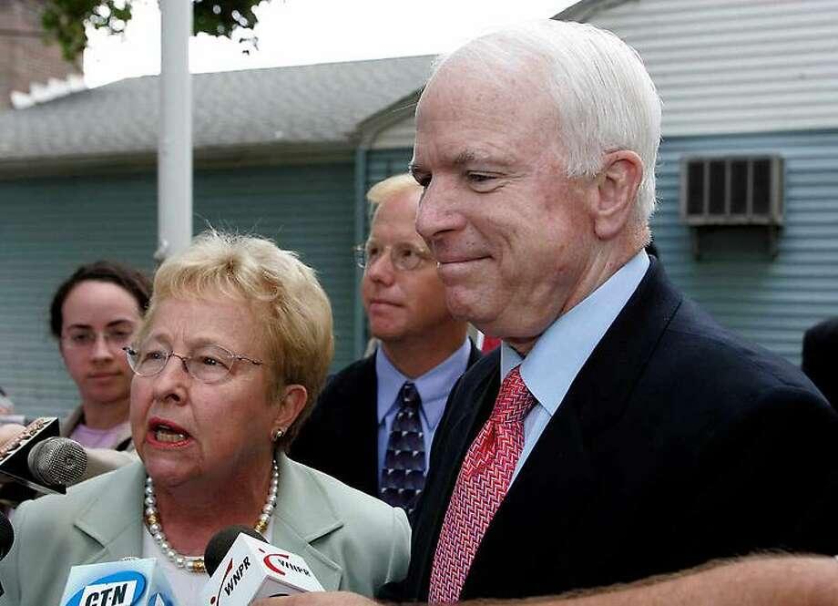 U.S. Rep. Nancy Johnson, R-Conn., left ,and U.S. Sen. John McCain, R-Ariz., speak to reporters upon their arrival at VFW Post 149 in Danbury, Conn., Monday, Sept. 18, 2006. McCain was appearing on Johnson's behalf. (AP Photo/Bob Child) Photo: ASSOCIATED PRESS / AP2006