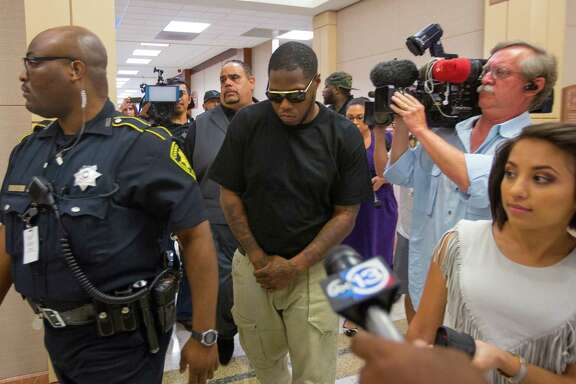 Rapper Z-Ro, whose given name is Joseph Wayne McVey, leaves the Harris County Courthouse on Thursday after a judge agreed to a motion for emergency protection for his former girlfriend, who accuses him of assaulting her.